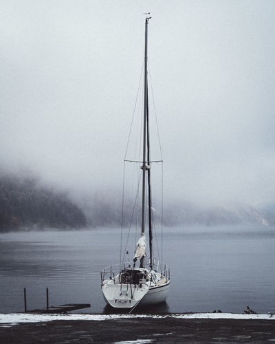 boat floating on the lake sils Nautical Vessel Water Sky Transportation Sea Pole Mast Mode Of Transportation Sailboat Fog Nature No People Sailing Beauty In Nature Day Tranquil Scene Scenics - Nature Tranquility Outdoors Yacht Luxury Swiss Mountains Moodygrams Moody Sky