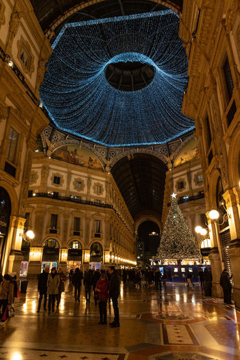 Architecture Illuminated Building Exterior Built Structure City Group Of People Dome Crowd Night Travel Destinations Travel Motion Real People Lighting Equipment City Life Women Large Group Of People Arch Building Walking Ceiling Galleria Vittorio Emanuele - Milano