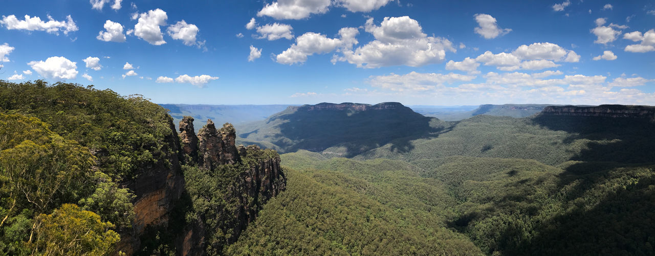 Three Sisters Rock Formation Aboriginal Blue Mountains National Park Forest Green Gunnedoo Jamison Valley Katoomba Tribe Landmark Meehni Mountain Rainforest Rock Formation Sky And Clouds Sunny Day Three Sisters Blue Mountains Travel Destinations Tree Wimlah