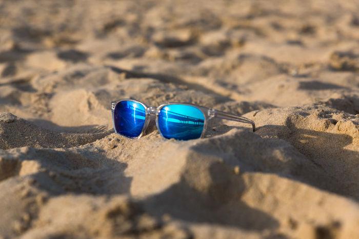 Sunglasses on the beach sand boscombe pier reflection Seascape Seaside EyeEm Selects EyeEm Gallery Holidays Vacations Enjoying Life Sand Boscombe Pier  Pet Portraits Beach Sunlight Shadow Selective Focus Outdoors