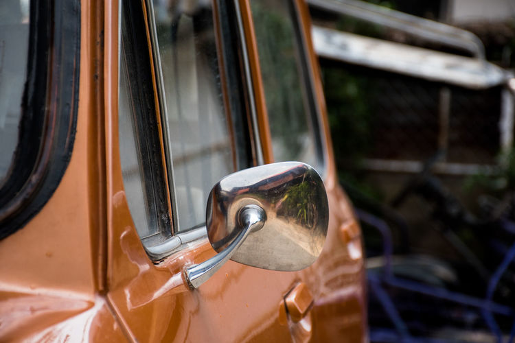 Close-up of side-view mirror in car
