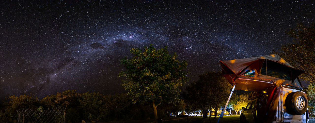 Watching the Milkyway in Namibia HUAWEI Photo Award: After Dark Namibia Africa Architecture Astronomy Beauty In Nature Built Structure Galaxy Illuminated Infinity Landscape Milky Way Milkyway Nature Night No People Outdoors Plant Scenics - Nature Sky Space Star Star - Space Star Field Tree A New Beginning
