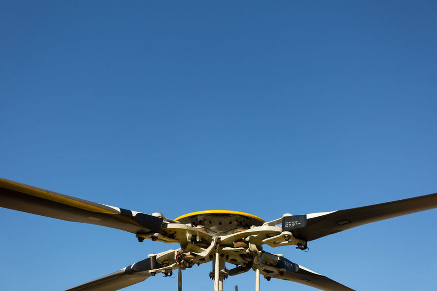Rotor Blades Aviation Blue Blue Sky Chopper Clear Sky Close-up Day Detail Flight Fly Helicopter High Section Low Angle View Minimal Minimalism Nature No People Outdoors Part Of Rotor Rotorcraft Sky