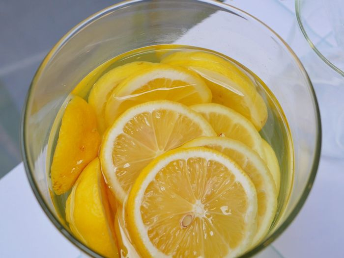 Close-up of lemon in glass on table