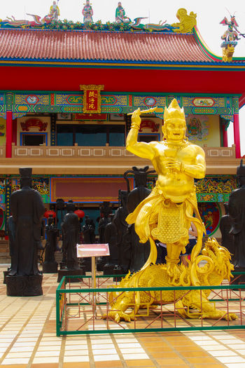 Beautiful Chinese's style sculptures at Anek Kusala Sala (Viharn Sien), Thai-Chinese temple in Pattaya, Thailand. It was built in 1987 and is one of popular tourist attractions Anek Kusala Chinese Doll Sculpture Park Viharnra Sien Ancient Architecture Building Exterior Built Structure Chinese Culture Chinese Temple Cultures Day Full Length Gold Colored Immortal Men Outdoors People Place Of Worship Religion Sculpture Sculpture Garden Spirituality Statue Travel Destinations Yellow