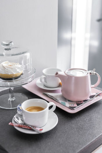 Coffee cup and tea on table
