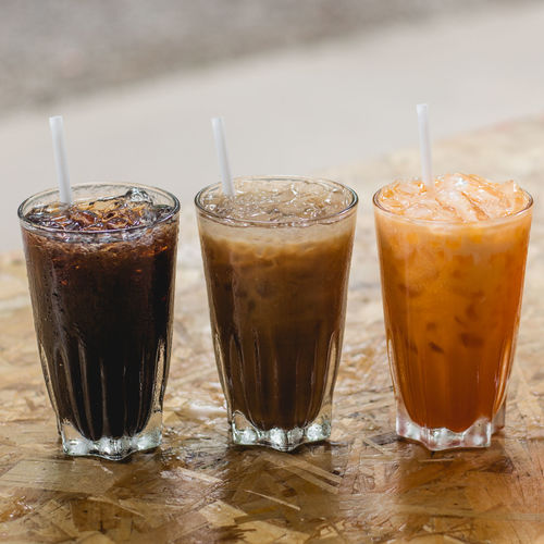 Close-up of iced drinks on table