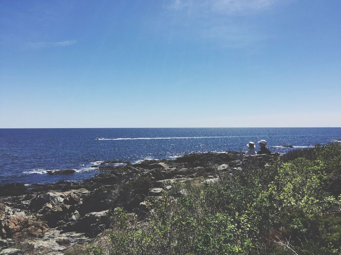 Sea Horizon Over Water Water Nature Tranquil Scene Scenics Beauty In Nature Tranquility Clear Sky Blue Outdoors Day Sky Vacations Blue Sky Wave People Relaxing Rocky Coastline