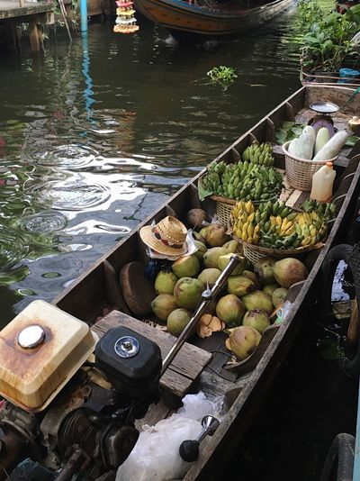 Several Thai fruits in long trail boat of floating market. High Angle View Vegetable Day Outdoors Water Food And Drink No People Food Healthy Eating Nautical Vessel Fruit Freshness Fruit Photography Long Trail Boat Floating Market Canals And Waterways Selling On The Boat Old Thai Lifestyle Rural Lifestyle