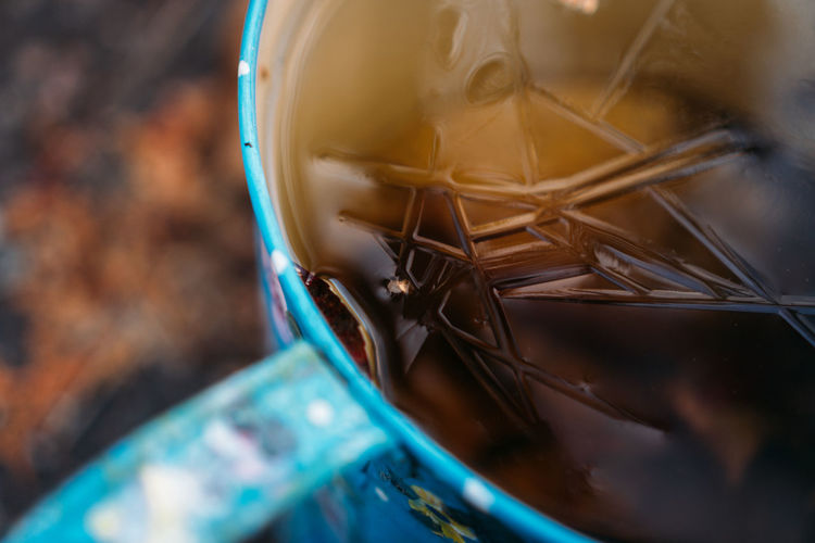 Close up of blue mug with cracked ice in it.