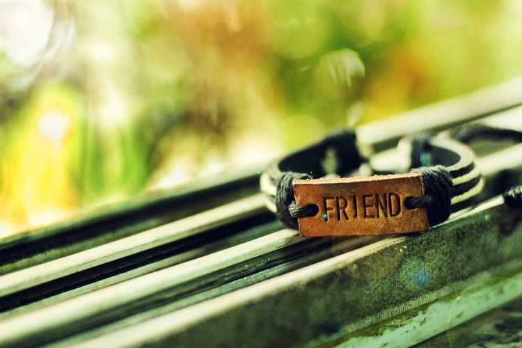 Text on bracelet over window sill