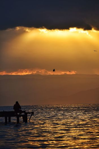Sunset Sky Water Orange Color Sea Beauty In Nature Silhouette Scenics - Nature Cloud - Sky Real People Nature Lifestyles Two People Vertebrate Idyllic Leisure Activity Tranquil Scene Animal Themes Tranquility Horizon Over Water Outdoors Sun Capture Tomorrow