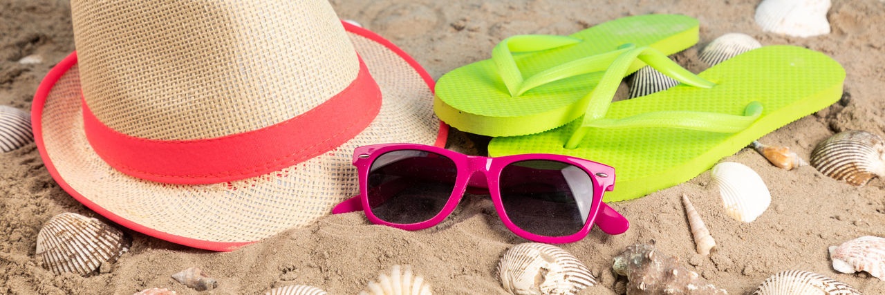 Beach Beach Towel Clothing Fashion Glasses Green Color Hat Holiday Land Nature No People Outdoors Personal Accessory Sand Sandal Shoe Slipper  Still Life Straw Hat Summer Sun Hat Sunglasses Vacations