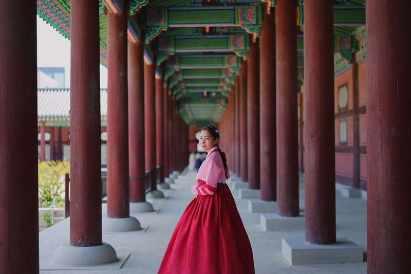 Diamond in the palace Diamond Palace Photographer Gyeongbokgung Palace, Seoul Hanbok South Korea🇰🇷 Clothing One Person Architecture Women Young Adult Fashion Adult Dress Built Structure Red Architectural Column Standing Full Length Young Women Real People Elégance Traditional Clothing Portrait Religion Hairstyle