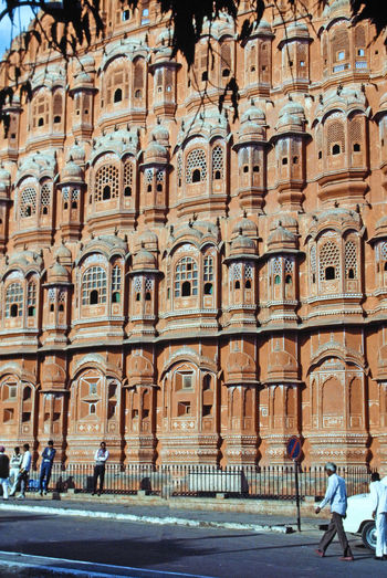 The Hawa Mahal (Palace of the Wind) - Jaipur, India Architecture People City Day Road Outdoors Arch Adult Adults Only Jaipur Rajasthan One Person Hawa Mahal Palace Pink City Jaipur A Taste Of India Palace Of The Wind, Jaipur