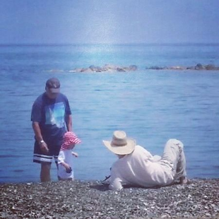 Too hot. Child Toddler  Happy Beach Sand Water Sea Ocean Sky Hat Grandad Daddy