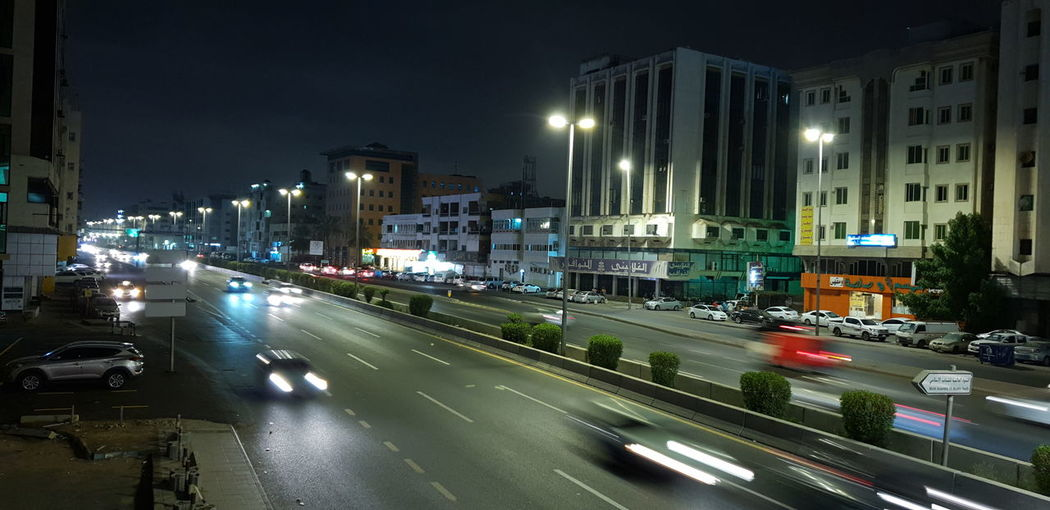 Traffic on road in city at night