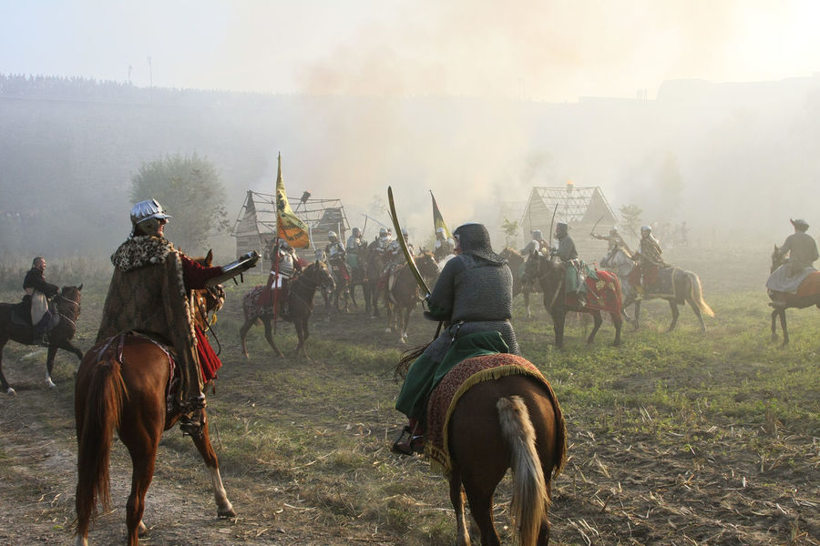 Battle Battlefield Cavalry Helmet Historical Reconstruction Historical Reenactment History Horse Horseback Riding Leisure Activity Old Weapon Old Weapons Outdoors People Reconstruction Group Riding Soldiers Ukraine Vintage XVII Century
