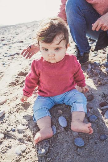 Cute baby girl on sand at beach