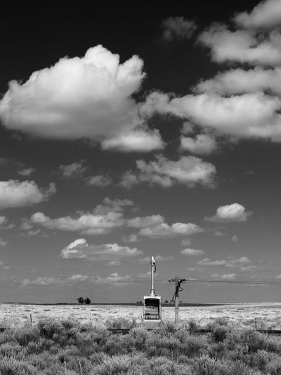 Low Lilt Atmosphere Black And White Cloud Cloud - Sky Desert Scrub High Plains Lonely Prairie Railroad Railroad Telegraph Railroad Track Sky Tranquil Scene