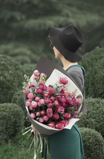 Hortensia Beauty In Nature Bouquet Close-up Day Florist Flower Flower Head Fragility Freshness Growth Hat Lifestyles Nature One Person Outdoors People Real People Rear View Standing Women
