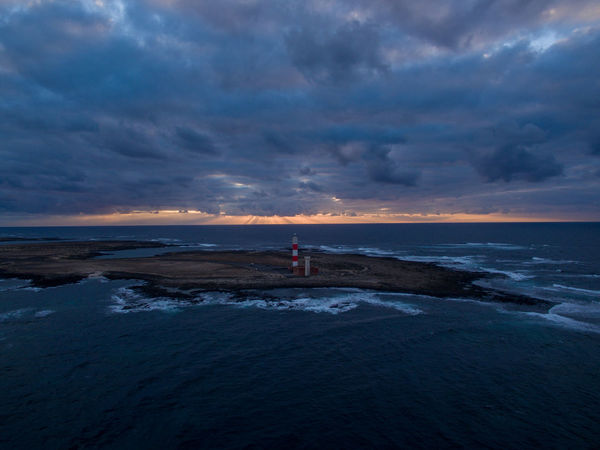 fuerteventura canarian islands spain drone aerial corralejo lighthouse sunset mystic clouds dark DJI Mavic Pro Fuerteventura Wanderlust Aboutpassion Aerial View Architecture Beach Beauty In Nature Building Exterior Built Structure Cloud - Sky Dronephotography Guidance Horizon Lighthouse Nature Outdoors Scenics - Nature Sea Sky Sunset Tower Tranquil Scene Vanlife Water