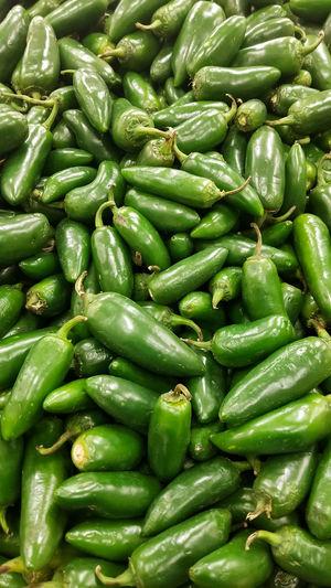 Full frame shot of green jalapeno peppers for sale at market