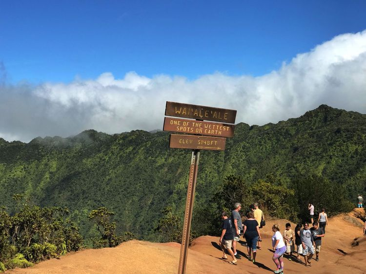 Overlooking Na Pali coast Sign Kauai Nā Pali Coast State Park Text Sky Mountain Cloud - Sky Communication Day Outdoors Adult Tree Beauty In Nature Men Real People Nature People An Eye For Travel