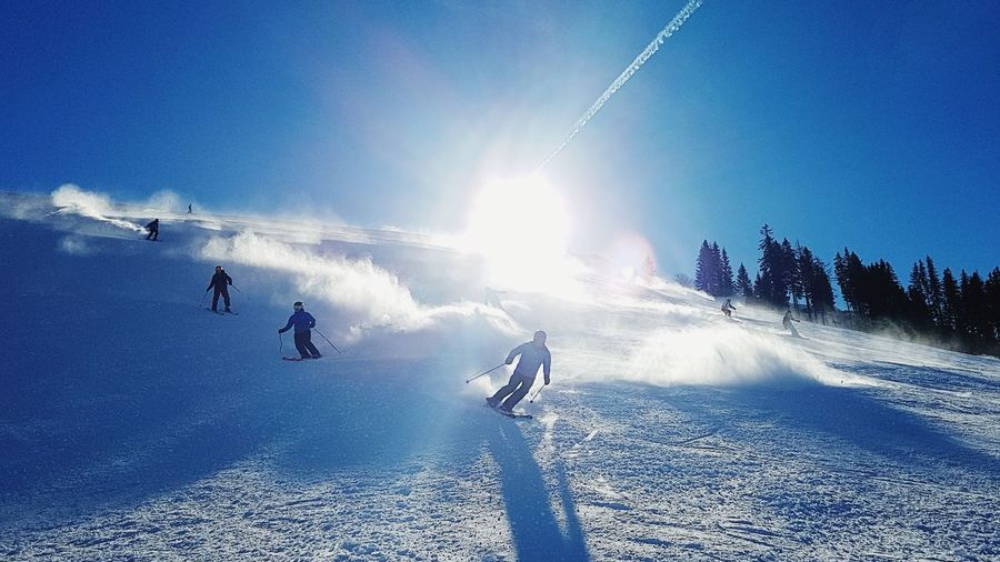 Wintersport Alps Cold Sun Sunflare Sunbeam Snowboarding Ski Holiday Sport Snow Winter Adventure Spraying Cold Temperature Blue Clear Sky Ski Slope Ski Resort  Ski Track Powder Snow Winter Sport Ski-wear Deep Snow Skiing Skiing Helmet