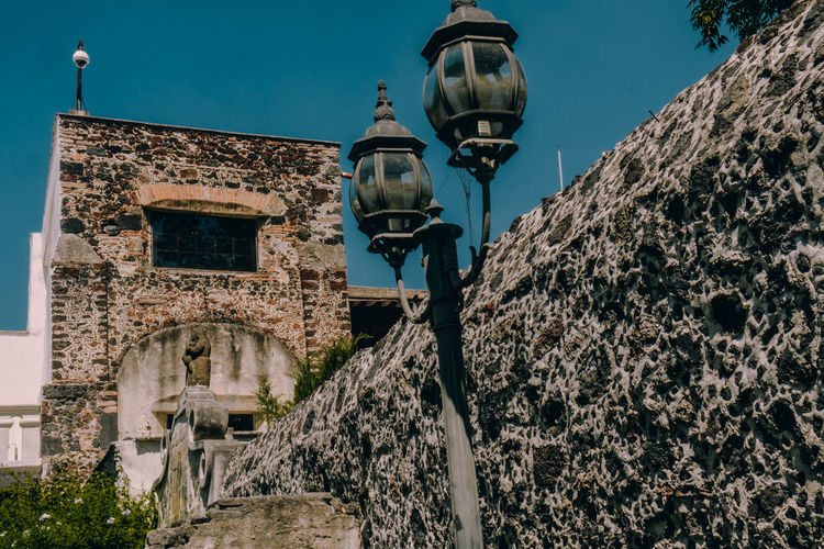 Entrando al Ex Convento del Desierto de los Leones Architecture Built Structure Building Exterior Lighting Equipment Street Light Low Angle View Building Old History Nature The Past No People Sky Street Day Wall Wall - Building Feature Outdoors Clear Sky Antique Electric Lamp Stone Wall