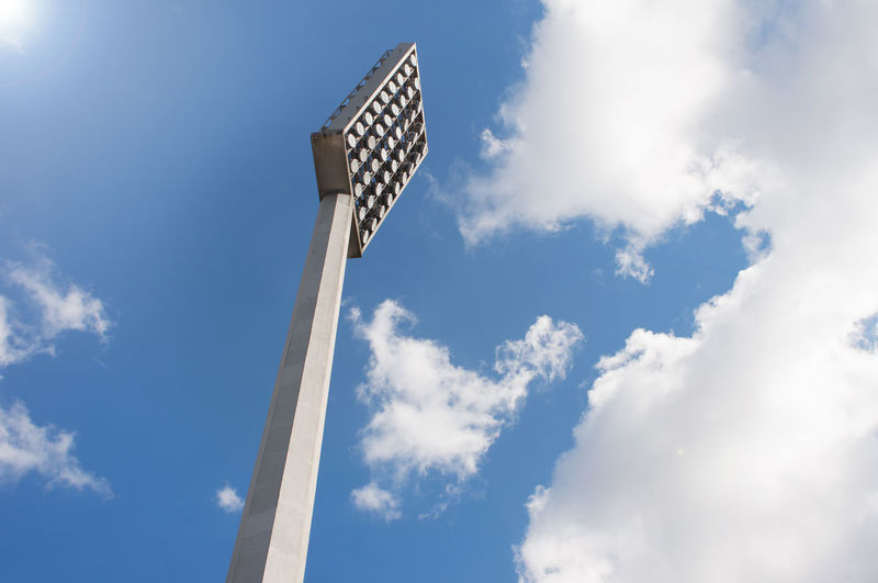 reflector at the stadium Cloud - Sky Sky Blue No People Day Architecture Built Structure Lighting Equipment Outdoors Tower Floodlight Technology Directly Below Electrical Equipment Tall - High Reflector Stadium Electricity  Object Sport Illumination Playground Metal Power Energy