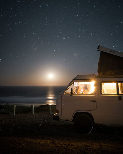 Volkswagen T3 Westfalia camper van under a starry sky on a clear night in Fuerteventura and the setting moon in the background. Sky Night Mode Of Transportation Transportation Land Vehicle Nature Land Illuminated Motor Vehicle Scenics - Nature No People Car Water Beauty In Nature Outdoors Beach Stationary Sea Motor Home Vanlife Vanlifers Vanlifediaries Vanlifeexplorers Vanliving Camper Campervan Camper Van Travel Travel Destinations Traveling Travel Photography Travelling Moon Moonlight Starry Starry Sky Stars Moon Shots Long Exposure Vwbulli Volkswagen VwT3 Vintage Vintage Car Nature Nature_collection Nature Photography Summer Camping Campinglife