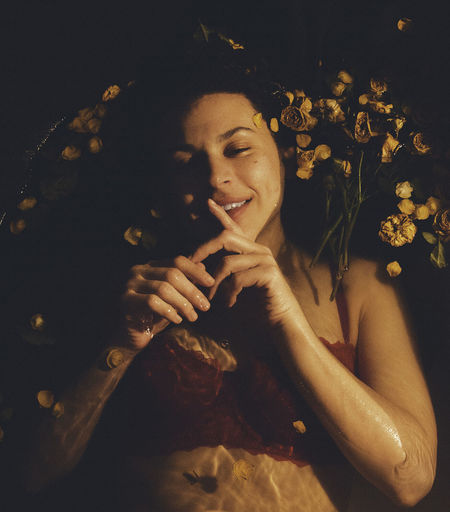 Beautiful Woman Beauty Cheerful Close-up Enjoyment Flower Freshness Happiness Indoors  Leisure Activity Lifestyles Lying Down Night One Person One Young Woman Only People Real People Relaxation Smiling Women Young Adult Young Women