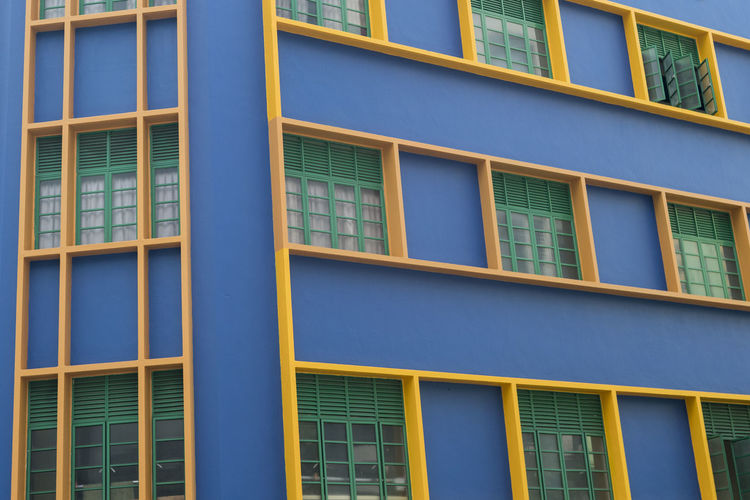 Singapore architecture Outdoors Singapore Architecture Architecture_collection Architecture Photography Built Structure Window Building Exterior Building Full Frame No People Low Angle View Pattern Yellow Day Repetition Glass - Material Residential District Blue In A Row Design City Apartment Window Frame Chinatown