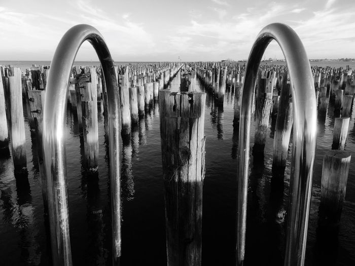 No more pier Hand Rail Derelict Pier Stumps Melbourne, Australia Jason Gines Water Sky Nature No People Metal Day The Mobile Photographer - 2019 EyeEm Awards Scenics - Nature In A Row Outdoors Beauty In Nature Tranquility Architecture Tranquil Scene Cloud - Sky Sunlight