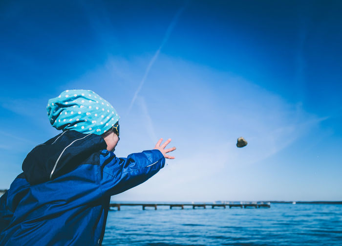 simple things make children happy 2 Blue Cloud - Sky Day Focus On Foreground Happy Nature One Person Outdoors Playing Sea Sky Throwing Stones In The Water Water