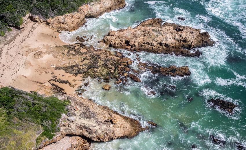 Beauty In Nature Day High Angle View Idyllic Land Motion Nature No People Non-urban Scene Outdoors Rock Rock - Object Rock Formation Rocky Coastline Scenics - Nature Sea Solid Tranquil Scene Tranquility Turquoise Colored Water