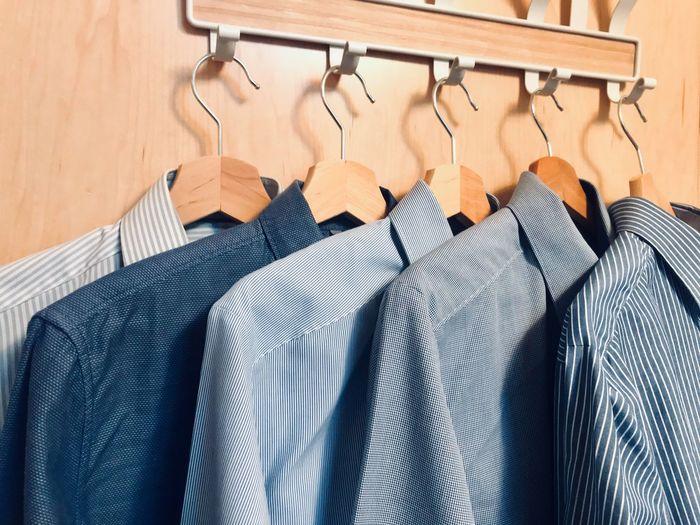 Shirts hanging on coat hook at home