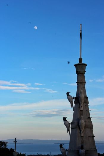 """""""IT"""" Statue Sky Sky And Clouds Blue Sky Seasky Birds Sculpture Human Representation Sky Blue Outdoors Travel Destinations Clear Sky Day Nature Architecture No People Moon Beach Sea"""
