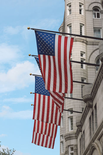 Low Angle View Of American Flags On Building