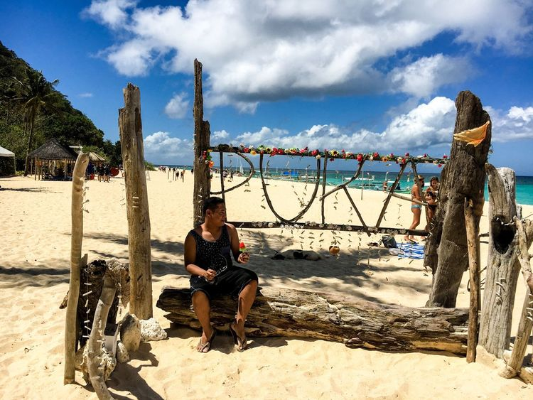 Puka Beach Boracay Puka Beach Vacation Sky Cloud - Sky Sitting Real People Day Outdoors One Person Sand Beach Young Adult Beauty In Nature Summer Exploratorium Summer Exploratorium Focus On The Story