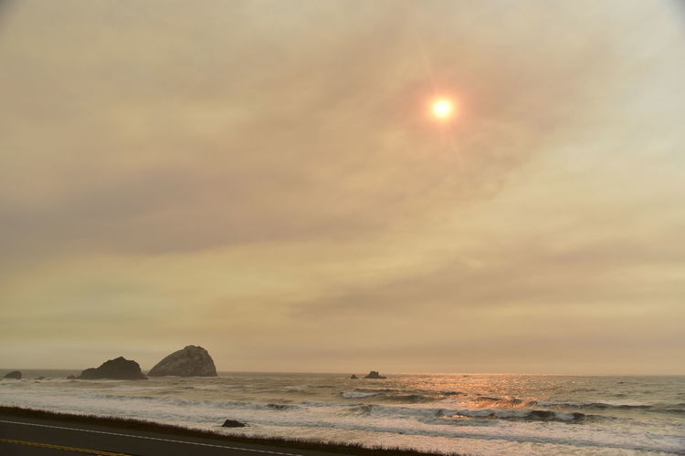 Beach Photography Oregon Smoke Beach Beauty In Nature Day Fire In The Sky Horizon Over Water Idyllic Nature No People Oregon Coast Outdoors Scenics Sea Sky Sun Sunlight Sunset Tranquil Scene Tranquility Water