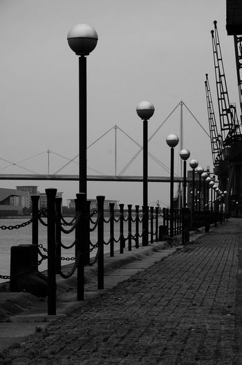 Street Light Bridge - Man Made Structure No People City Sky Suspension Bridge Outdoors River Thames River Thames Docklands Blackandwhite Cityscape Geometric Architecture Geometric Shape Geometry Architectural Detail Architecture Lines Streetphotography Streetphoto_bw First Eyeem Photo FirstEyeEmPic Landscape