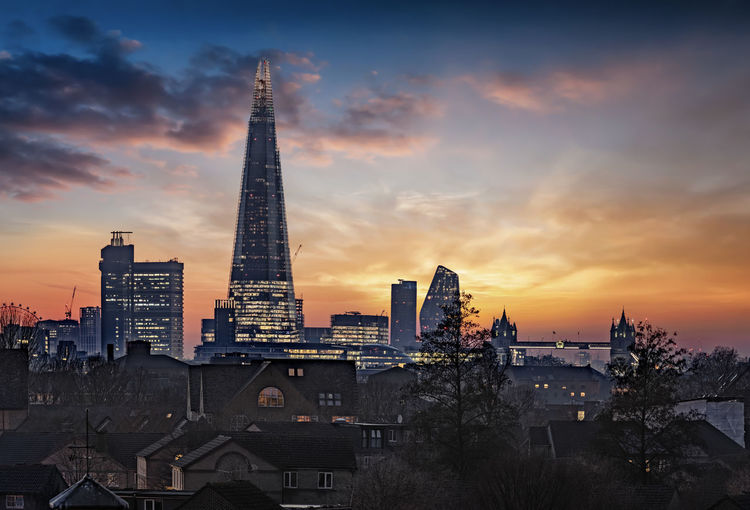 The diverse skyline of London during a fiery sunset, United Kingdom Architecture Building Exterior Built Structure Sky City Sunset Building Tall - High Travel Destinations Cloud - Sky Cityscape Skyscraper Tourism Travel London Skyline Urban United Kingdom Houses Roof City Cityscape Panorama Dusk Sunrise