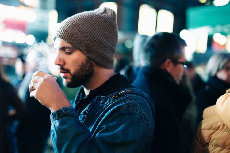 Guy drinking a hot wine during winter eyeemnewhere