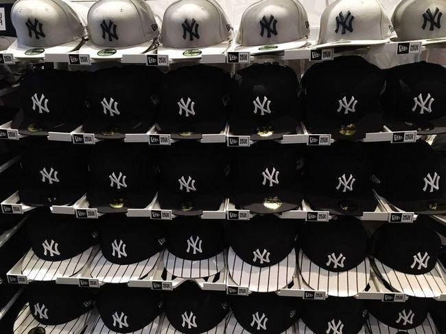 Merchandise Baseball Sportswear Sport New York Yankees Shop Fan Cap Yankees Baseball Cap In A Row Repetition Shelf Large Group Of Objects Abundance Indoors  No People