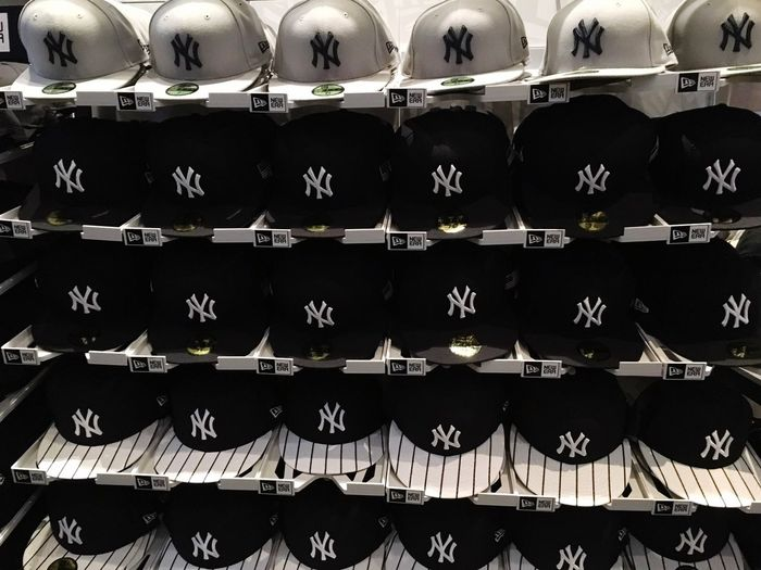 Merchandise Baseball Sportswear Sport New York Yankees Shop Fan Cap Yankees Baseball Cap In A Row Repetition Shelf Large Group Of Objects Abundance Indoors  No People
