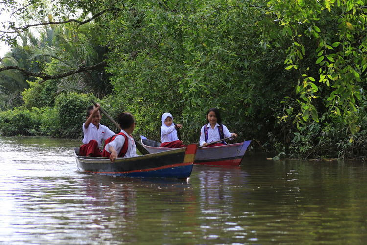 River way My Best Photo Tree Water Nautical Vessel Men Sitting Togetherness Women Forest Sailing River Boat