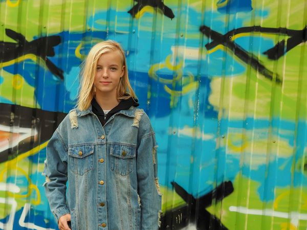 Young girl One Person Graffiti Front View Standing Real People Wall - Building Feature Lifestyles Creativity Day Casual Clothing Clothing Looking Away Leisure Activity Outdoors Looking Hairstyle