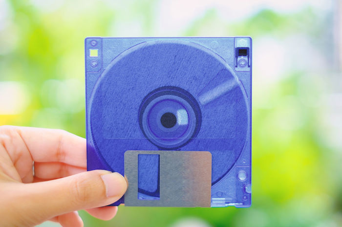 Classic File Floppy Blue Computer Data Disk Diskette Floppy Disk  Hand Holding Information Media Old Storage Technology